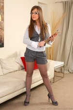 Cate Harrington Wearing Grey Shorts And Grey Waistcost - Picture 1