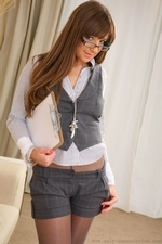 Cate Harrington Wearing Grey Shorts And Grey Waistcost - Picture 3