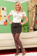 Gorgeous blonde in a tight white blouse and black miniskirt with sheer black pantyhose - 01