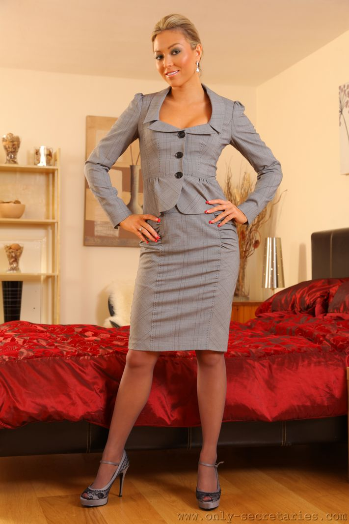 Blonde secretary stripping to her stockings