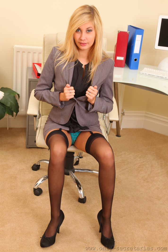 Long legged blonde in black stockings