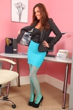 Sexy redhead in turquoise pantyhose - 02