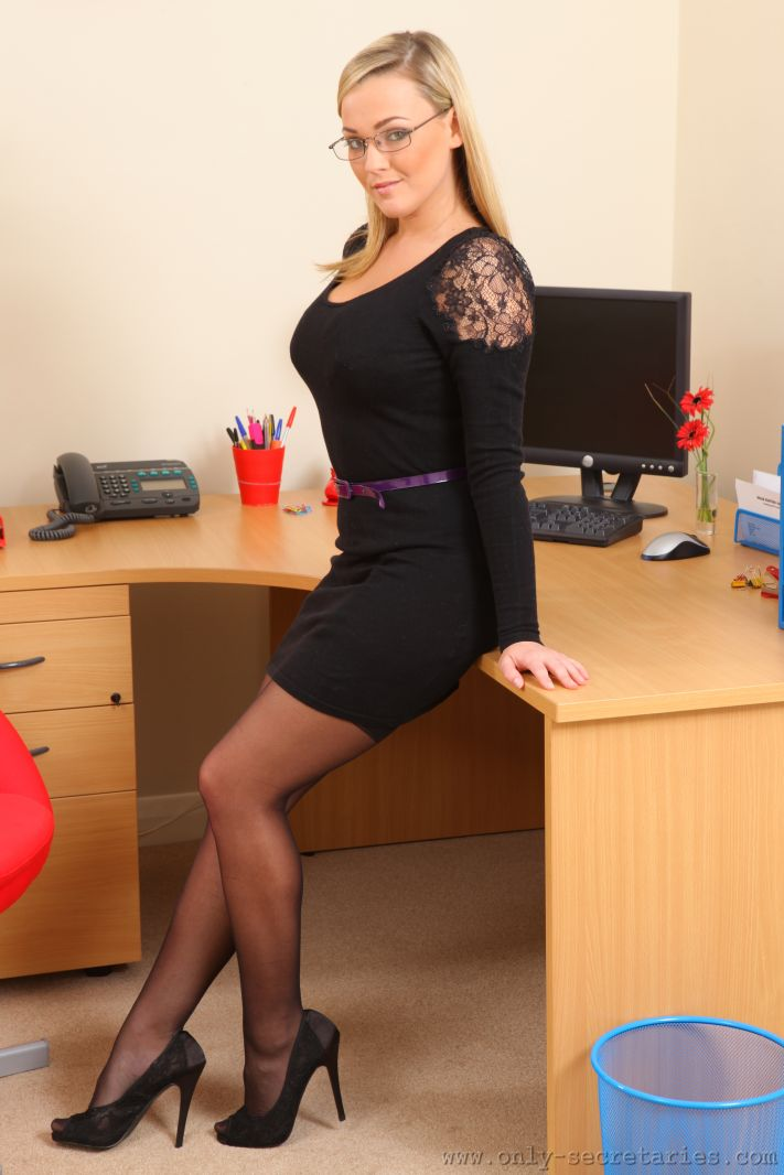 Naughty secretary does a sexy strip in her office