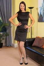 Sabrina C In Her Little Black Dress And Stockings - Picture 1