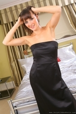 Nadia E looks sexy and sophisticated in her floor length black evening dress and high heels - 03