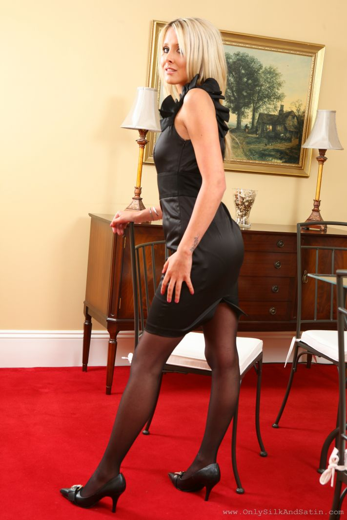 Rachael F looks cute in black evening dress and stockings