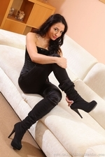 Brunette in tight satin trousers - 11