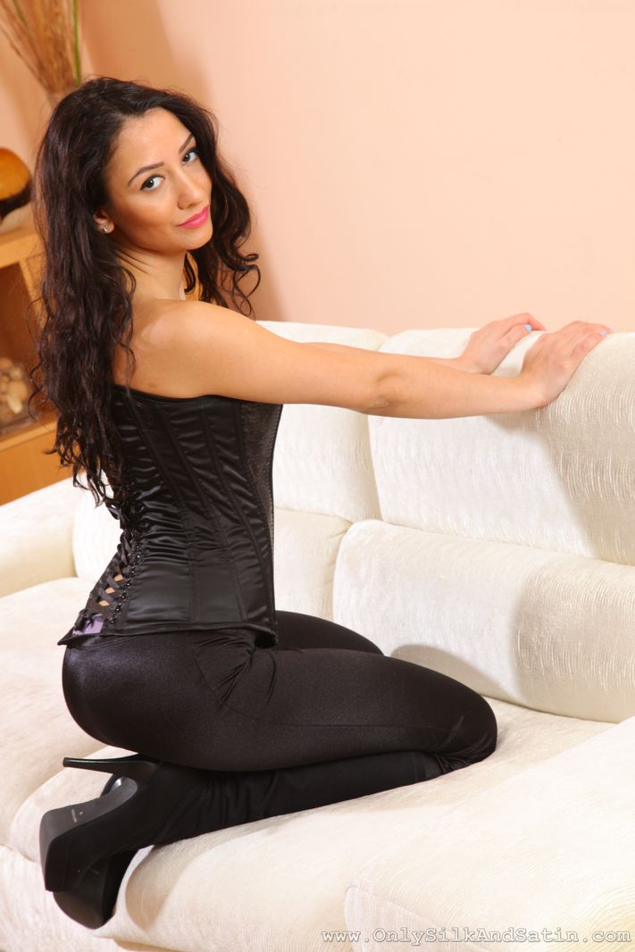 Brunette in tight satin trousers